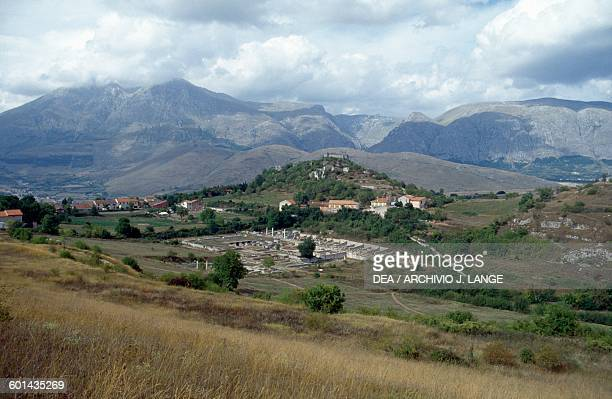 View of the archaeological site of the ancient Roman city of Alba Fucens with the Orsini Castle in the background Massa d'Albe Abruzzo Italy