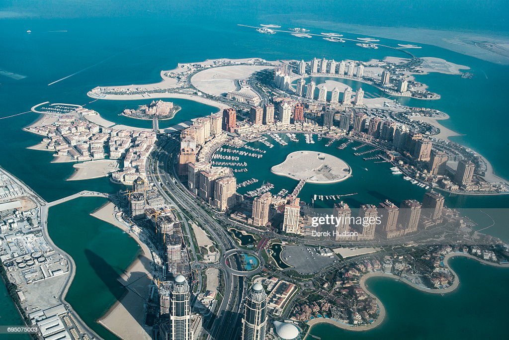 A view of the artificial island known as The Pearl that spans nearly 4 million square meters jutting out from the city of Doha, 350 metres offshore of Doha's West Bay lagoon. It is said to create over 32 kilometres of new coastline upon completion for use as a residential estate expected to house over 18,000 dwellings and 45,000 residents by 2018, believed to cost $15 billion when completed. The picture was taken from a Qatar airlines flight departing Doha.