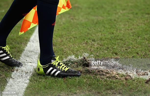A view of the assistant referee's boots during the 2014 FIFA World Cup Brazil Group D match between England and Italy at Arena Amazonia on June 14...
