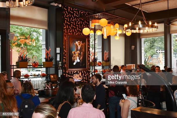 View of the atmosphere as The Spotted Cheetah opens in New York City with celebrity chef Anne Burrell serving up a limitedtime Cheetosinfused...