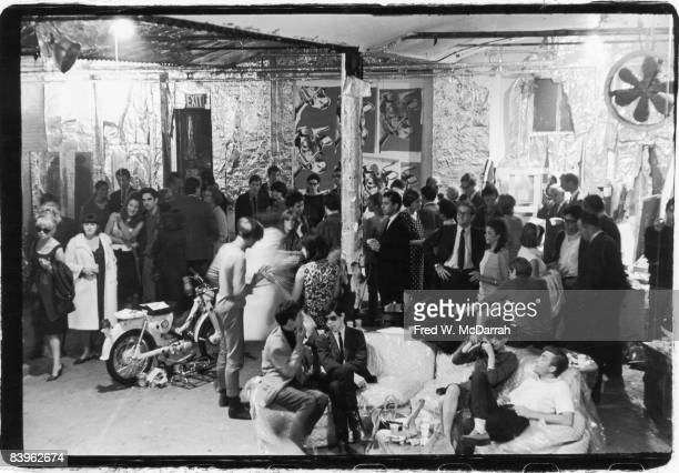 View of the attendees at a party in pop artist Andy Warhol's studio the Factory New York New York August 31 1965 Among those pictured are American...