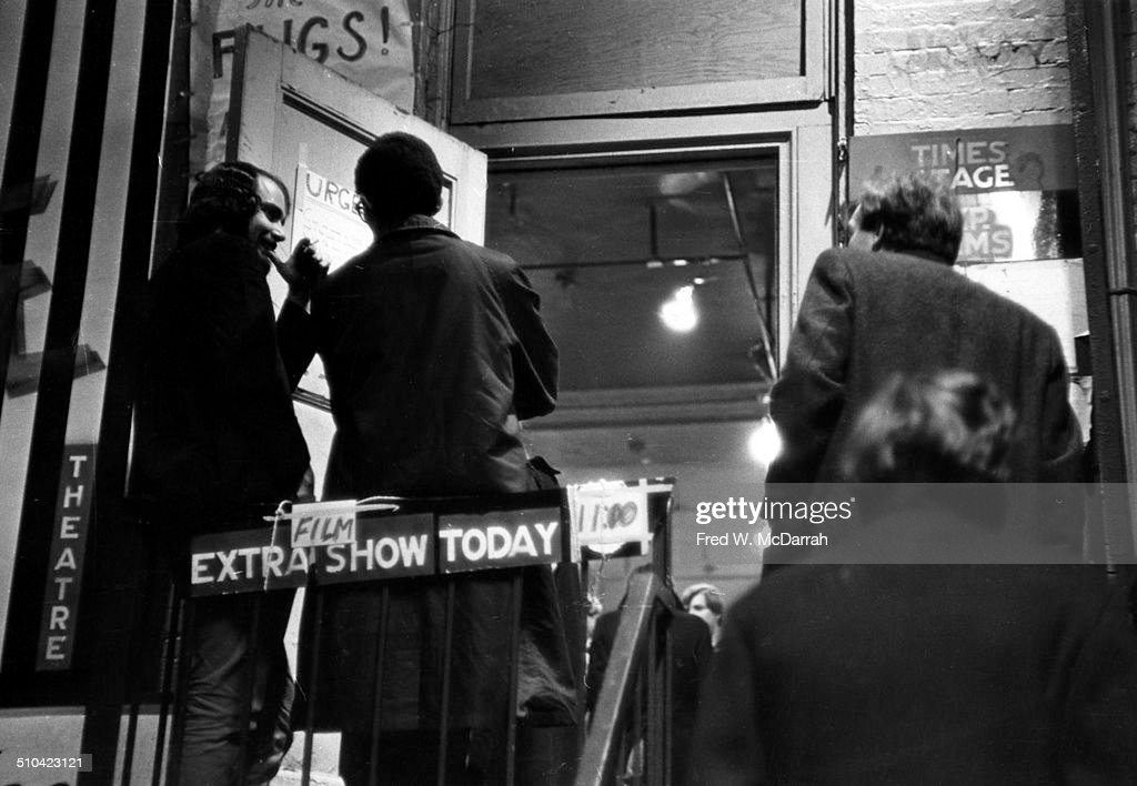 View of the audience as they arrive at the Bridge Theatre, in the Hamilton-Holly House (4 St Marks Place), for a perfomance by rock band the Fugs, New York, New York, November 2, 1965.