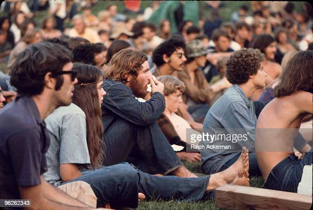 View of the audience as they watch a performance on the 'Free Stage' at the Woodstock Music and Arts Fair Bethel New York August 1969 The 'Free...