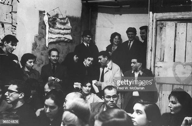 View of the audience at Claes Oldenburg's performance art piece 'Ironworks/Fotodeath ' at the Ruben Gallery New York New York February 25 1961 The...
