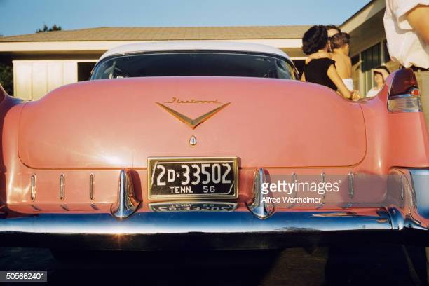 Alfred Wertheimer/Getty Images View of the back of a pink Cadillac Fleetwood car given to Elvis Presley's mother Gladys parked the driveway of his...