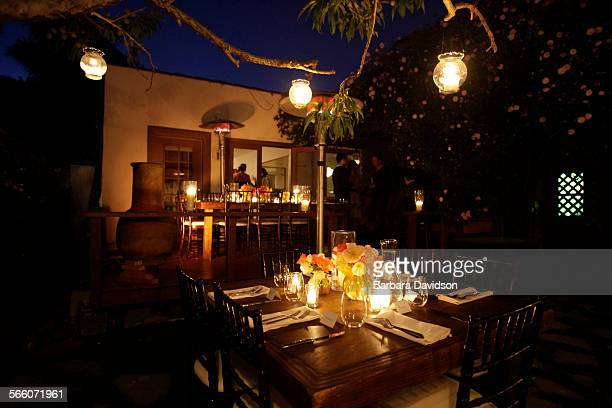 View of the backyard ready for a dinner party for 17 guests at Jennifer McGarigle' s Venice home May 2 2010 It's a hybrid story design and...