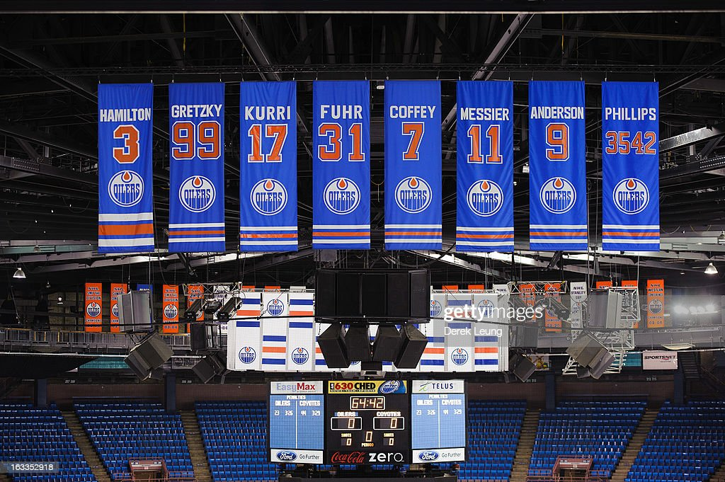 A view of the banners for radio broadcaster Rod Phillips and the retired numbers of previous Oilers players Glenn Anderson #9, Mark Messier #11, Paul Coffey #7, Grant Scott Fuhr #31, Jari Kurri #17, Wayne Gretzky #99, and Al Hamilton #3 as photographed before an NHL game between the Edmonton Oilers and the Phoenix Coyotes at Rexall Place on February 23, 2013 in Edmonton, Alberta, Canada.
