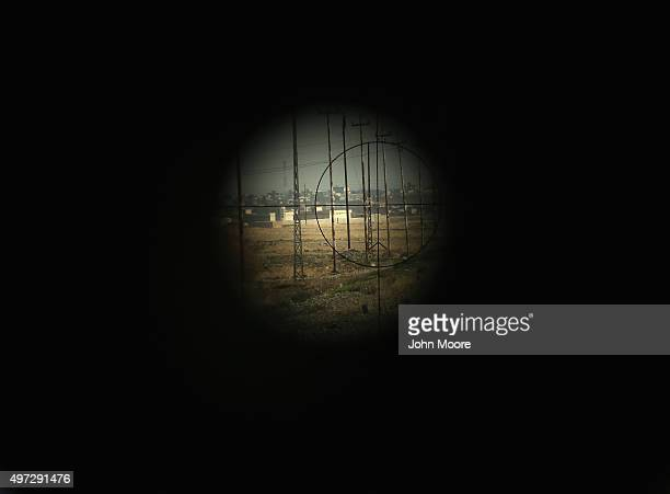 A view of the battlefield is seen through the scope of a Milan antitank missile from a Peshmerga position on the new frontline on November 15 2015...