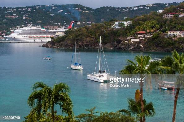 CONTENT] A view of the bay in the US Virgin Island of St Thomas Various ships and sailboats and catamarans dot the landscapevacation fun tropics