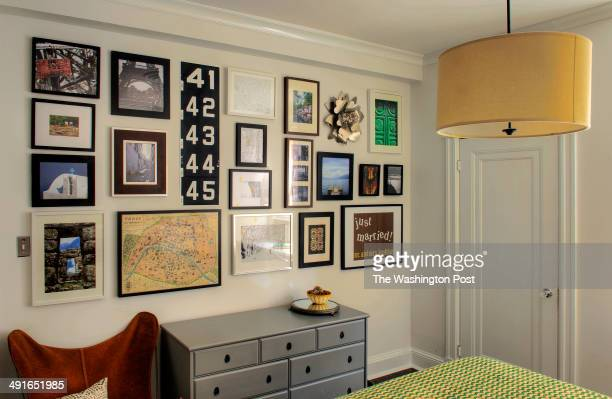 A view of the bedroom showing the wall of mixed artwork in Kiera and Michael Kushlan's 750 square foot condo which has won awards for design on...