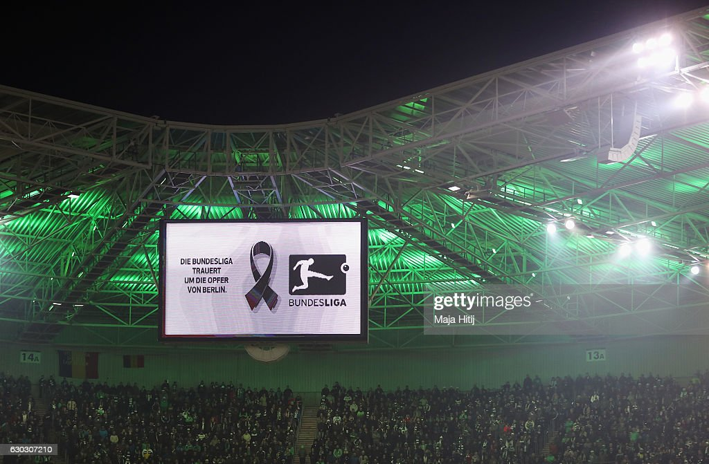 A view of the big screen as the teams and fans observe a minute's silence to remember the victims of the Berlin attack prior to the Bundesliga match between Borussia Moenchengladbach and VfL Wolfsburg at Borussia-Park on December 20, 2016 in Moenchengladbach, Germany.