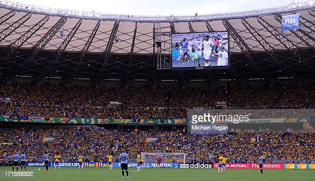 View of the big screen as the tenth anniversary of the death of footballer MarcVivien Foe is remembered prior to the FIFA Confederations Cup Brazil...