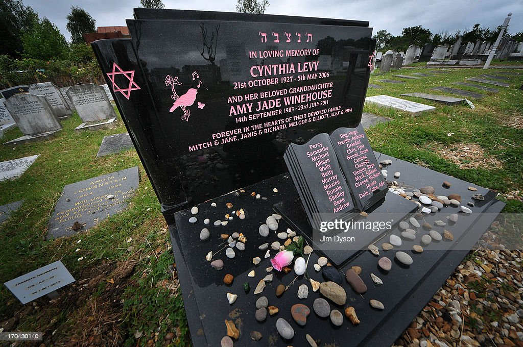 A view of the black marble headstone that marks the final resting place of Singer Amy Winehouse at Edgwarebury Jewish cemetery on June 12, 2013 in London, England. Winehouse died of alcohol poisoning on July 23, 2011.