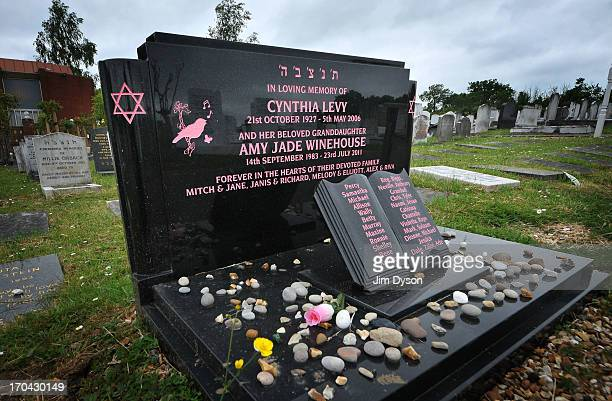A view of the black marble headstone that marks the final resting place of Singer Amy Winehouse at Edgwarebury Jewish cemetery on June 12 2013 in...