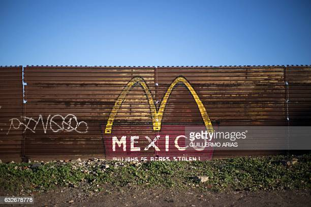 TOPSHOT View of the border fence between Mexico and US taken from Mexico's side on January 25 in Tijuana northwestern Mexico US President Donald...