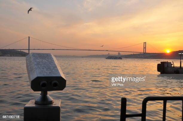 View of the Bosphorus at sunset seen from âengelk_y on the Asian side of Istanbul with the Bosphorus Bridge in the background