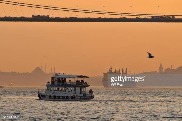 View of the Bosphorus at sunset with the Bosphorus Bridge and the Istanbul skyline in the background
