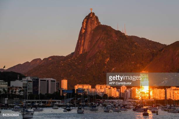 View of the Botafogo cove in the Guanabara Bay with Christ the Redeemer statue atop the Corcovado mountain at dawn in Rio de Janeiro Brazil on...
