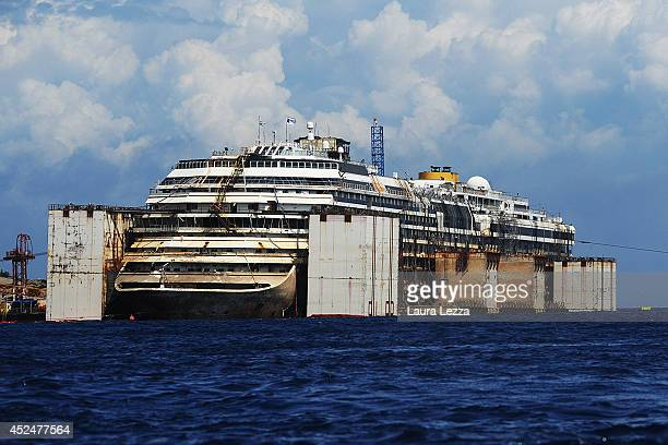 A view of the bow of the wrecked cruise ship Costa Concordia as it sits in the water during the last stage of refloating operation on July 21 2014 in...