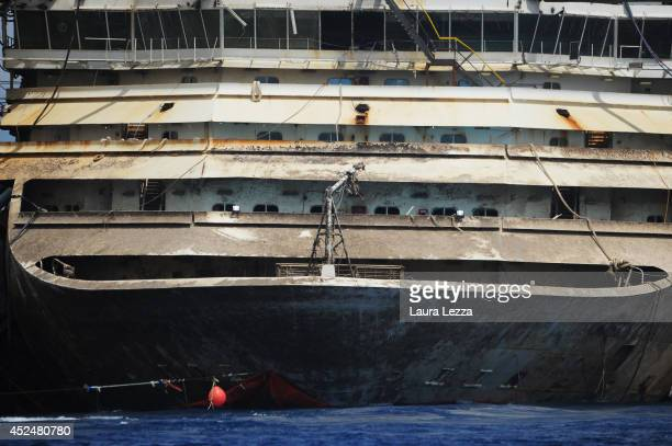 A view of the bow of the wrecked cruise ship Costa Concordia as it sits in the water during the last stage of the refloating operation on July 21...