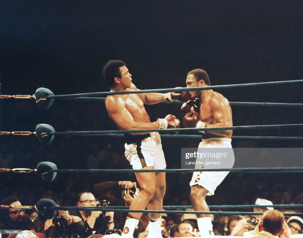 View of the boxing match between American heavyweights boxer <a gi-track='captionPersonalityLinkClicked' href=/galleries/search?phrase=Muhammad+Ali+-+Boxer+-+Born+1942&family=editorial&specificpeople=93853 ng-click='$event.stopPropagation()'>Muhammad Ali</a> and Joe Frazier at Madison Square Garden, New York, New York, January 28, 1974. In a close match, Ali won on points and went on to meet George Foreman for the world heavyweight title.