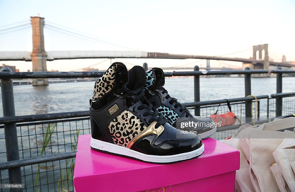 A view of the Brooklyn Bridge and shoe products during the 'Surfer's Paradise' album release party at Beekman Beer Garden Beach Club on July 16, 2013 in New York City.