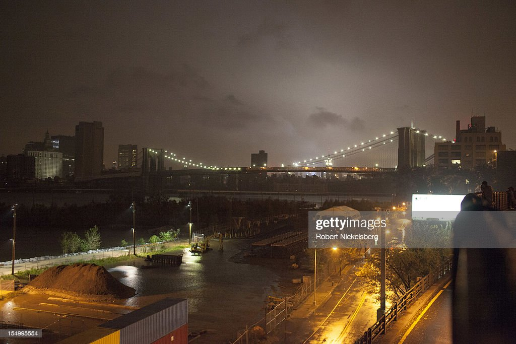 A view of the Brooklyn Bridge from along Brooklyn Heights' Promenade after Hurricane Sandy hit October 29, 2012 in the Brooklyn borough of New York. Electricity in Lower Manhattan had been turned off. The storm, which threatens 50 million people in the eastern third of the U.S., is expected to bring days of rain, high winds and possibly heavy snow.