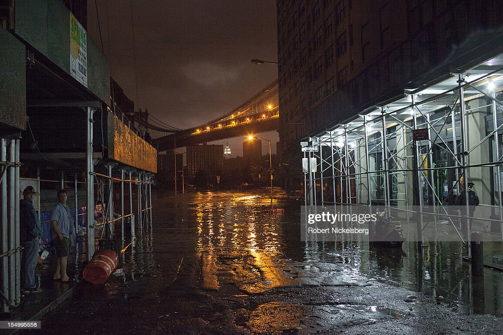 A view of the Brooklyn Bridge from Dumbo after Hurricane Sandy hit, on October 29, 2012 in the Brooklyn borough of New York. Electricity in Lower Manhattan had been turned off. The storm, which threatens 50 million people in the eastern third of the U.S., is expected to bring days of rain, high winds and possibly heavy snow.