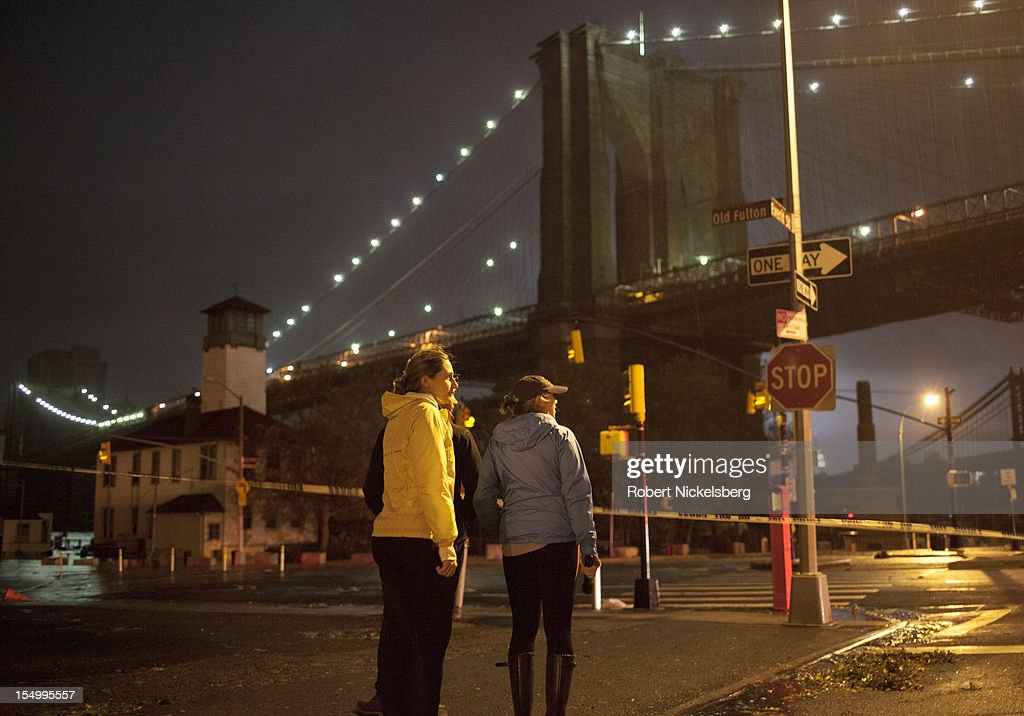 A view of the Brooklyn Bridge the as the high tide starts to recede after Hurricane Sandy hit on October 29, 2012 in the Brooklyn borough of New York. in the Brooklyn borough of New York. Electricity in Lower Manhattan had been turned off. The storm, which threatens 50 million people in the eastern third of the U.S., is expected to bring days of rain, high winds and possibly heavy snow.