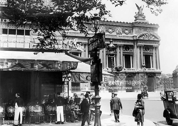 View Of The Cafe De La Paix Located On Place De L'Opera In Paris In 1925