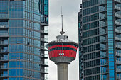 A view of the Calgary Tower between two apartment block in Calgary city center On Wednesday 13 July 2016 in Calgary Canada