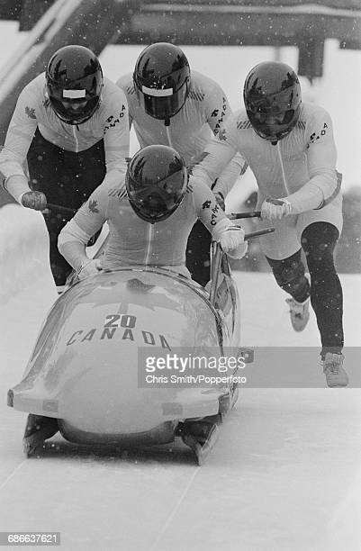 View of the Canada fourman bobsleigh team of Alan MacLachlan Clarke Flynn Robert Wilson and David Leuty in action at the start of competition to...