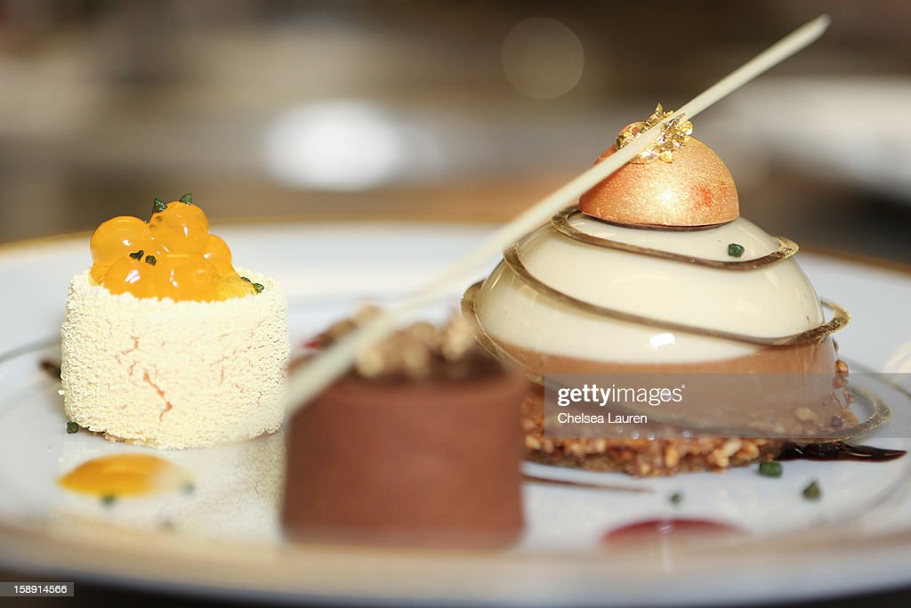 A view of the cappuccino mousse dome, orange sanguine and chocolate salted caramel dessert prepared by executive pastry chef Thomas Henzi for the 2013 Golden Globe Awards at The Beverly Hilton Hotel on January 3, 2013 in Beverly Hills, California.