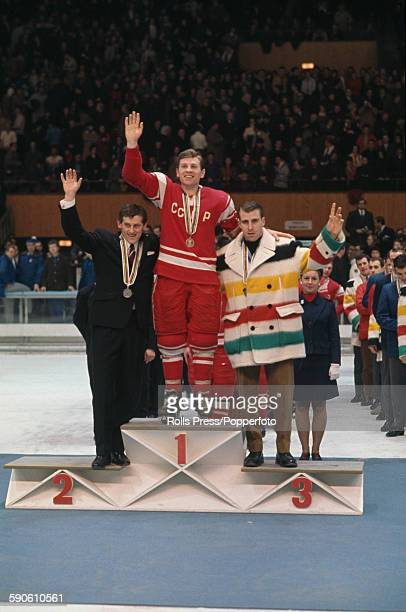 View of the captains of the medal winning ice hockey teams standing together on the podium at the medal ceremony of the Men's ice hockey tournament...