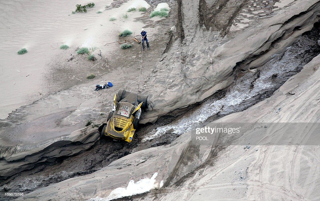 View of the car of French Pacal Thomasse stuck during the Stage 11 of the Dakar 2013 between La Rioja and Fiambala, Argentina, on January 16, 2013. The rally takes place in Peru, Argentina and Chile between January 5 and 20.