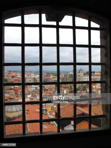 View of the Cathedral and the old town of Porto through the bars of a window of the Portuguese Center of Photography was previously city jail...