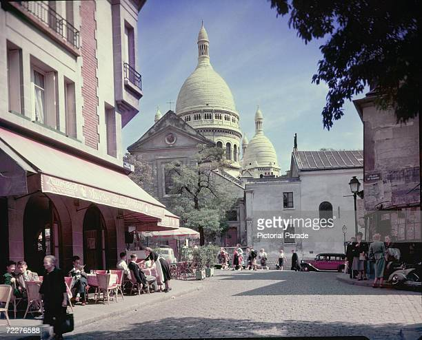 A view of the cathedral of SacreCoeur from the Place Du Tertre Montmartre Paris circa 1950