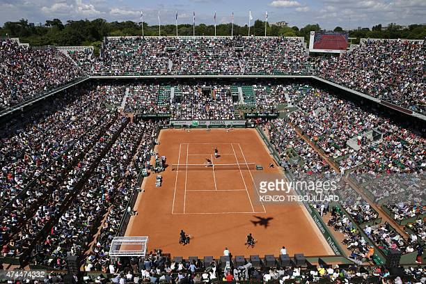 View of the central court during an exhibition match ahead of the Roland Garros 2015 French Tennis Open in Paris on May 23 2015 AFP PHOTO / KENZO...