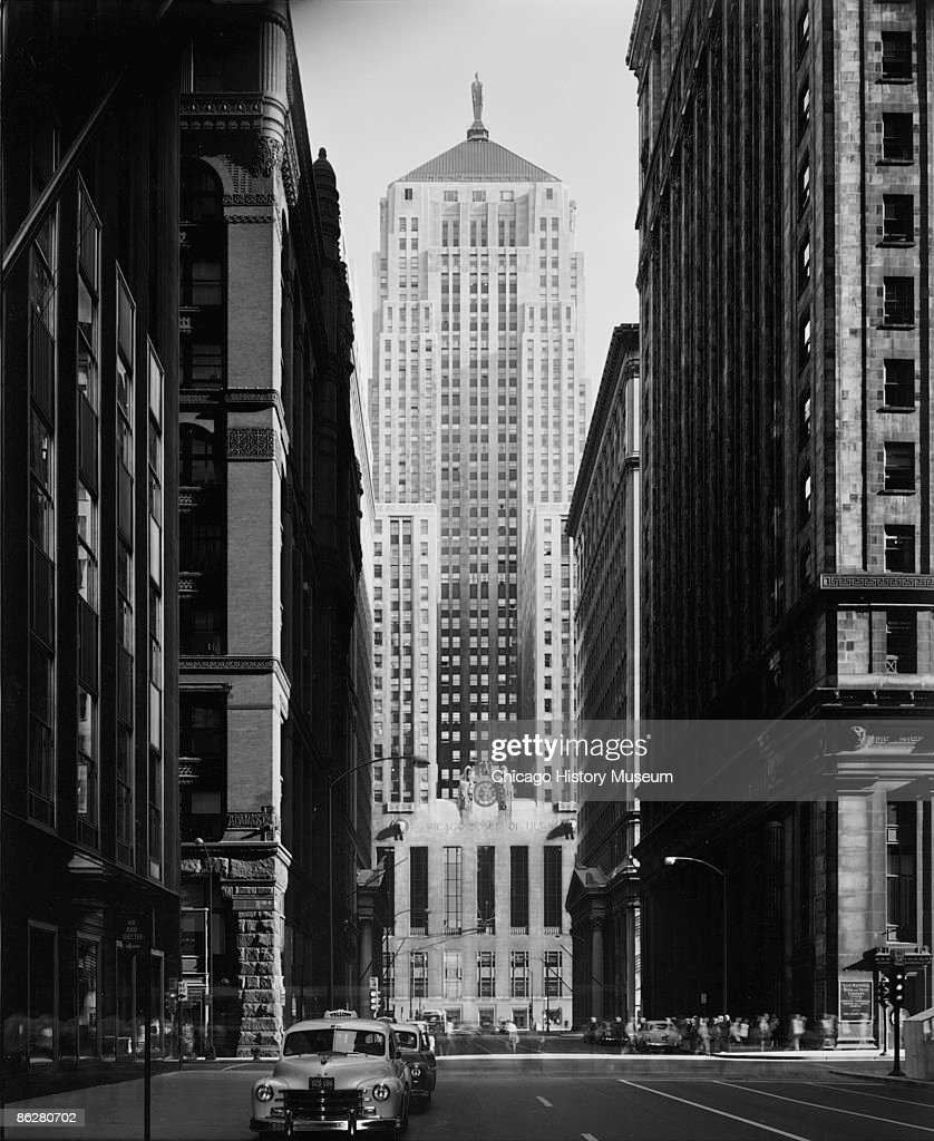 View of the Chicago Board of Trade building, which anchors the south end of LaSalle Street in Chicago, 1954. The building was designed by the firm of Holabird and Root. From the Hedrich-Blessing collection.