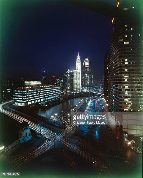 View of the Chicago River and Wacker Drive at night Chicago Illinois circa 1960s The Chicago SunTimes Chicago Daily News Wrigley Building and Tribune...
