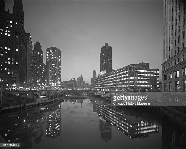 View of the Chicago River at night near the Chicago SunTimes Building Chicago Illinois circa 19401965