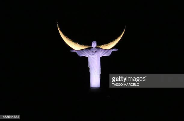 View of the Christ the Redeemer statue with the new moon in the background forming a shape as if the statue had wings in Rio de Janeiro Brazil on...