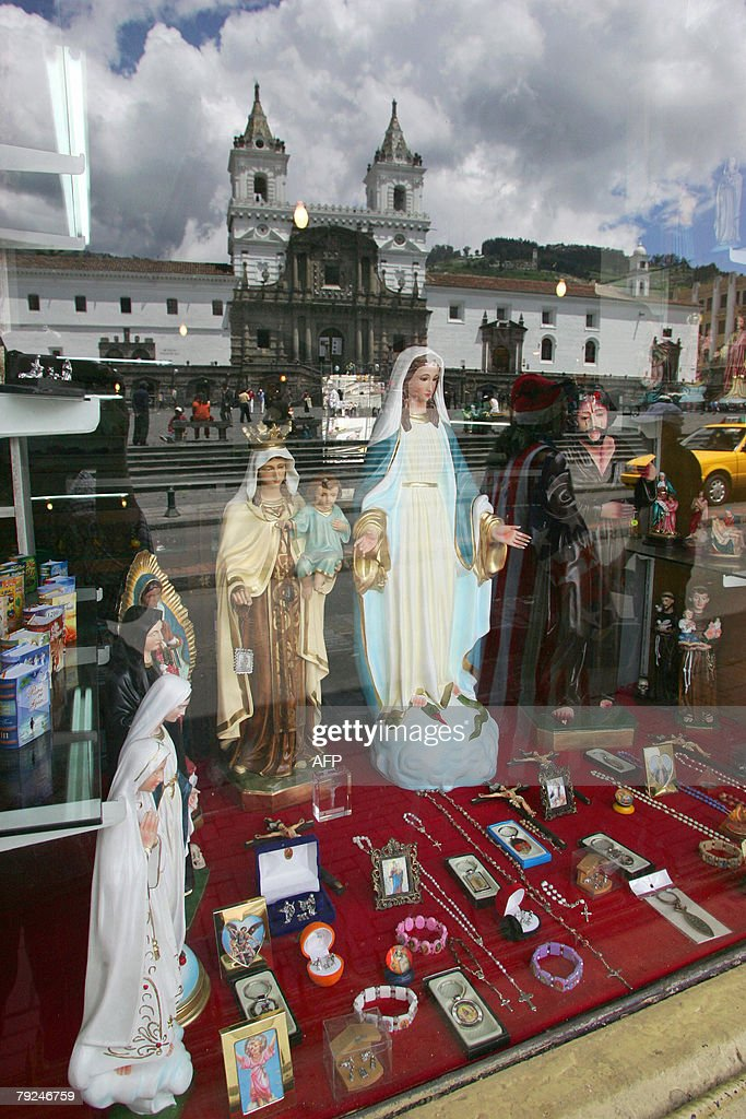 A view of the Church of San Francisco reflected off the window of a religious store in the historic center of Quito, 25 January, 2008. The city of San Francisco de Quito was founded by Spanish conquistador, Sebastian de Benalcazar, in 1534 and was the first city to be named a Historical and Cultural World Heritage Site by UNESCO in 1978. AFP PHOTO/Rodrigo BUENDIA