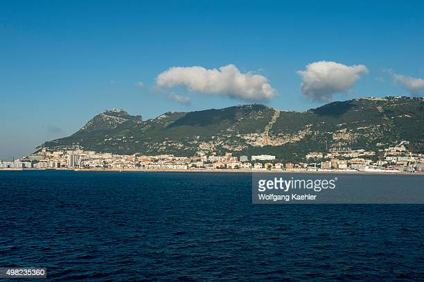 View of the city and the Rock of Gibraltar from sea which is a British Overseas Territory located on the southern end of the Iberian Peninsula at the...