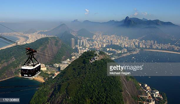A view of the city as a cable car heads up Sugar Loaf Mountain ahead of the of FIFA Confederations Cup Brazil 2013 on June 7 2013 in Rio de Janeiro...