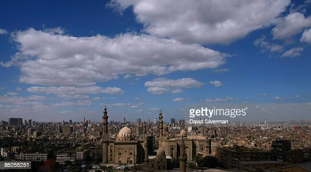 A view of the city is dominated by the Mamluk 14th century madrasa and mausoleum of Sultan Hassan and the early 20th century Ottomanera neoMamluk...