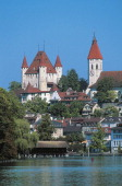 View of the city of Thun on the Aare river and Lake Thun with Schlossberg in the background Canton of Bern Switzerland