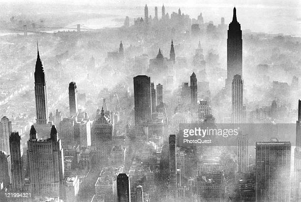 View of the city skyline partially obscured by smog New York 1973