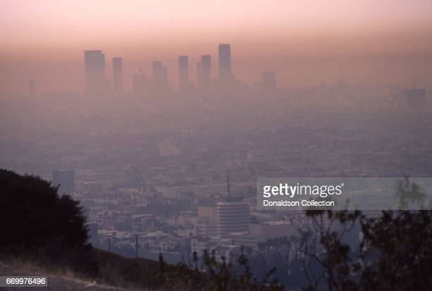 A view of the cityscape and downtown skyline with the Capitol Records building in the foreground from Mulholland Drive in May 1984 in Los Angeles...