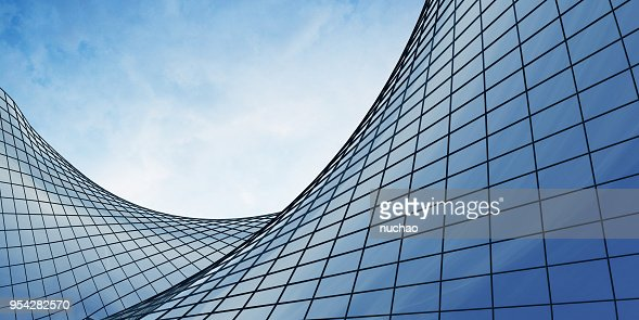 View of the clouds reflected in the curve glass office building. 3d rendering : Stock Photo